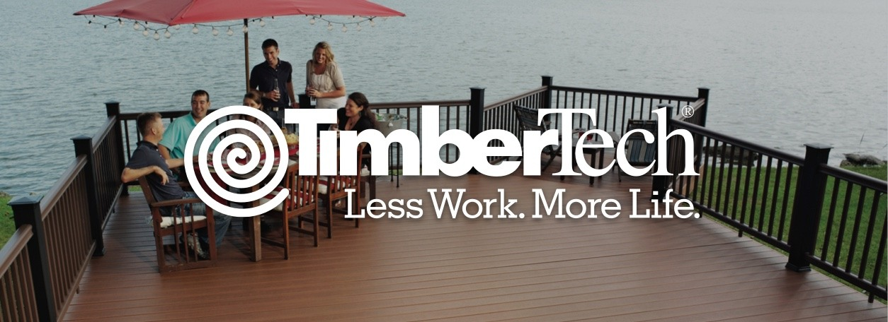 "TimberTech logo with ""Less Work. More Life."" quote and people on deck sitting at patio furniture on lake deck"