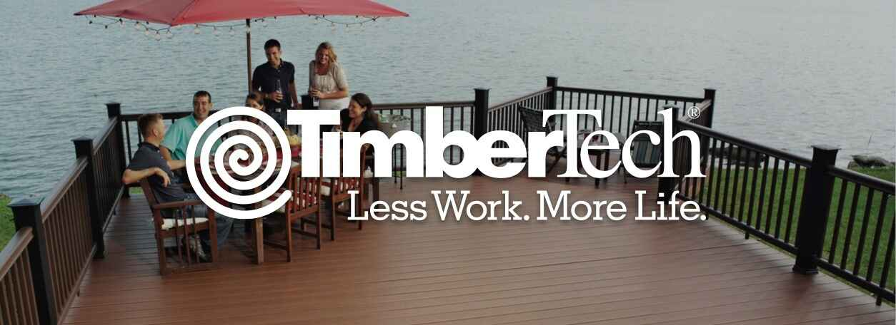 """TimberTech logo with """"Less Work. More Life."""" quote and people on deck sitting at patio furniture on lake deck"""