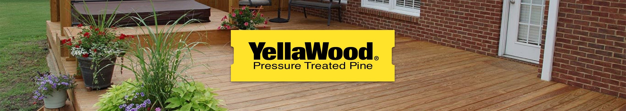 YellaWood logo with backyard deck and patio of brick home